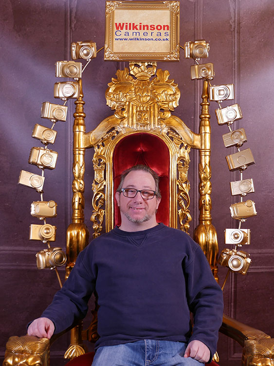 Andy Warn sits on camera throne