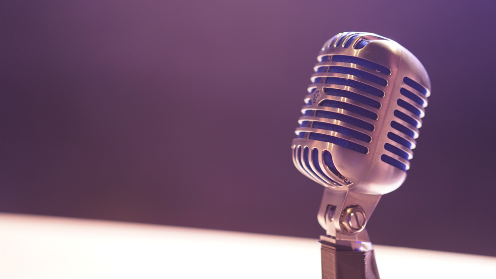 microphone on purple background
