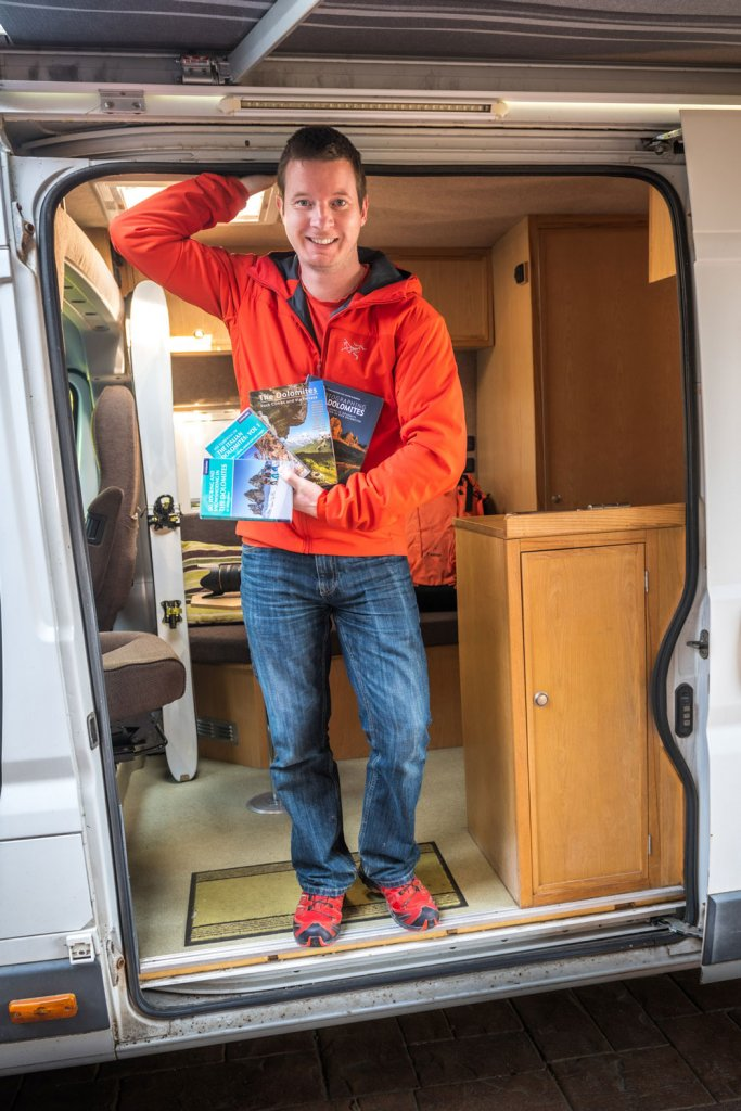 James Rushforth in his van holding his books