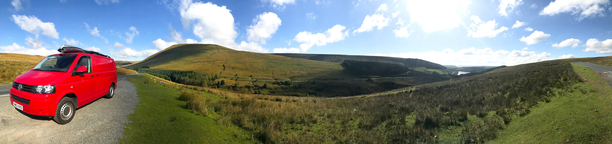 panorama of campervan in the hills
