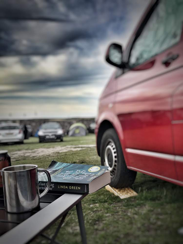 Relaxing outside the campervan
