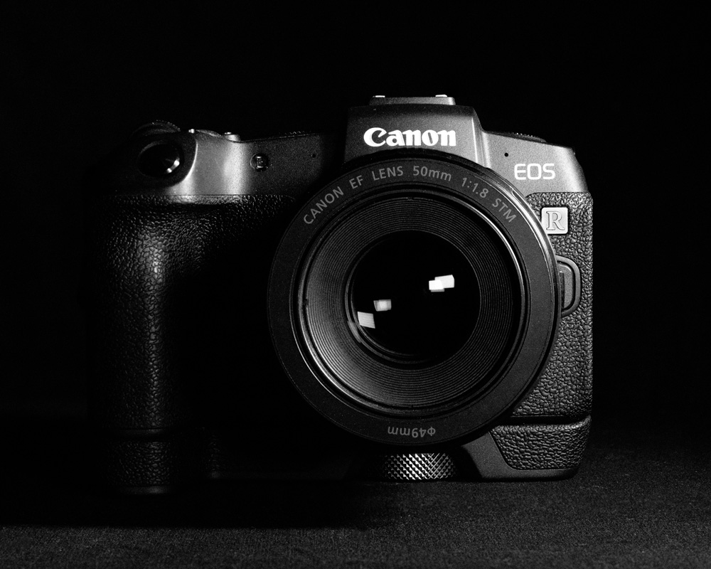 black and white image of Canon EOS R camera